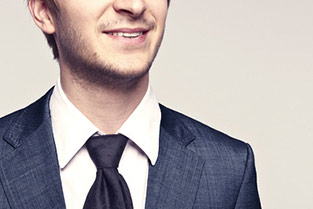 Young smiling guy in suit